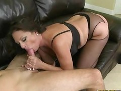 This dark haired milf is curious about juicy meaty cocks. She sucks one and strips down to her black lingerie at the same time. This nasty mom sucks non-stop and then finally finds her pussy banged from behind.